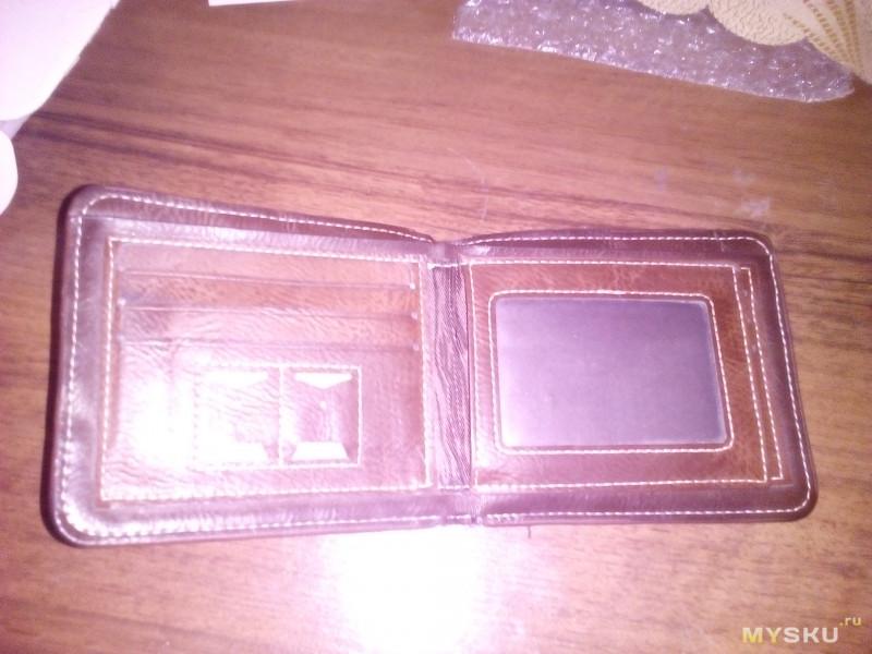Китайский кошелек из кожи молодой PUмы после года эксплуатации