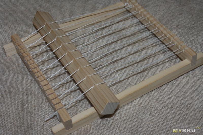 Простейший ткацкий станок из Китая. Почувствовать себя в каменном веке